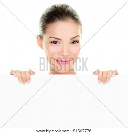 Asian chinese beauty woman showing holding banner sign peeking above white billboard leaning on empty blank whiteboard holding card with hands. Healthy happy fresh face girl isolated, white background