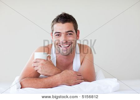 Man Having Breakfast In Bed