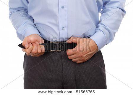Businessman tightening his belt concept for recession or economic depression