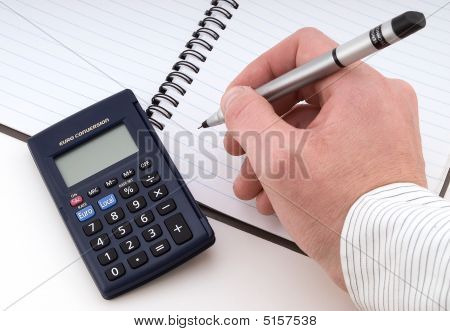 Working In Business, With Pen And Calculator