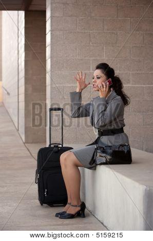 Angry Hispanic Woman Traveler Talking On Cell Phone