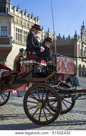 Horse Drawn Carriage On Old Town Square In Krakow, Poland.