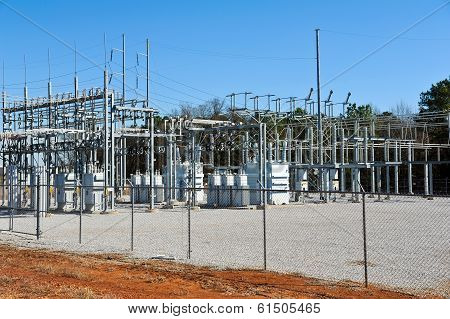 A High Voltage Electric Substation with Transformers poster