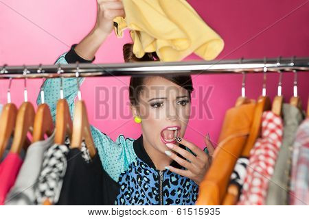 Time for refreshing wardrobe young attractive surprised woman searching for clothing in a closet