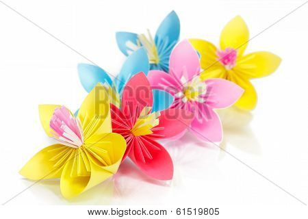 Paper Colored Flowers On A Glass