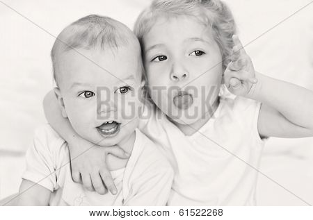 Happy Little Sister Hugging Her Brother
