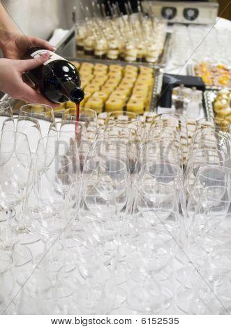 Waitress Filling a Wineglass