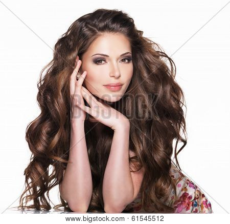 Beautiful adult woman with long brown curly hair. Fashion model over white background poster