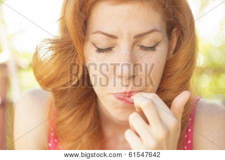 Pin-up girl tasting dessert