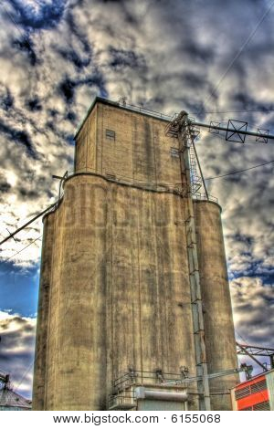 Grain Elevator With Dramatic Sky In Hdr