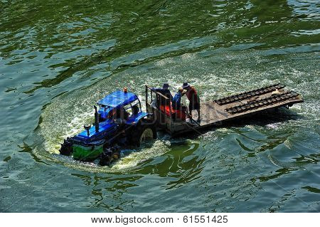 Tracter Drove On Flood In Bangkok