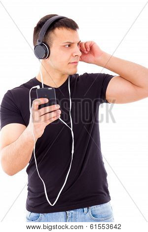 Stunned Curious Man Listening Something On Mobile Over Headphones