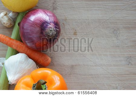 A Group Of Vegetables On A Wooden Cutting Board