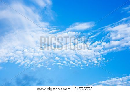 Blue sky with fleecy clouds background