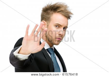 Portrait of business man stop gesturing, isolated on white
