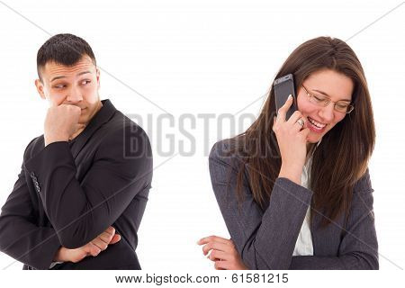 Suspicious Man Looking At His Woman Talking On The Phone