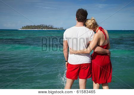 Couple At The Sean With Desert Island In Background