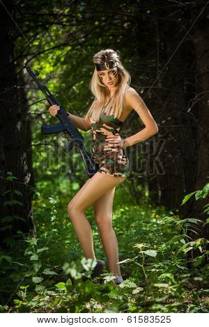 young woman holding an automatic assault rifle