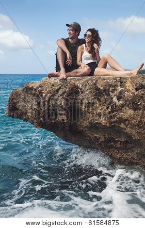 Beautiful Couple Sitting On A Rock And Looking At The View