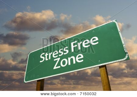 Stress Free Zone Green Road Sign And Clouds