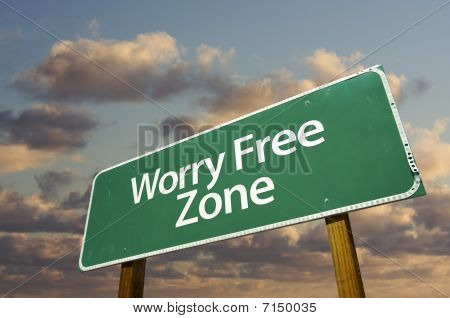 Worry Free Zone Green Road Sign And Clouds