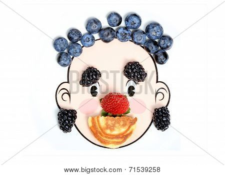 Happy face made with fresh berries and pancake.