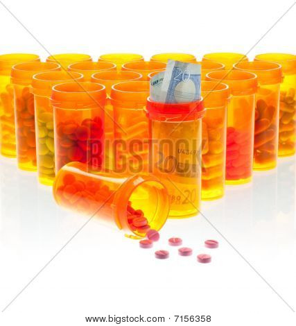 The High Cost Of Health Care.  Pills And Euro Currency In Pill Bottles Isolated On White.