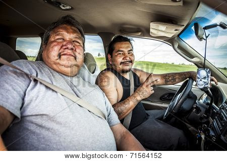 Pine Ridge Indian Reservation, Sd, Usa - July 1, 2014:  Two Of Oglala Native Americans Driving Throu