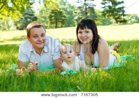 Mom, Dad And  Son In Park