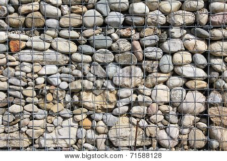 modern easy-care fence filled with pebble stones poster