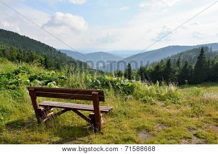 Summer mountains Czech Republic Jeseniky. Bench in the mountains for rest and relaxation in nature.
