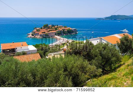 The famous resort of Montenegro located on the small islet Sveti Stefan nowadays is connected to the mainland by the isthmus. poster