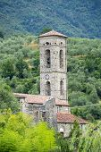 Codiponte (Massa e Carrara Tuscany Italy) old village in Lunigiana: the medieval church of Saints Cornelio and Cipriano built in 12th century poster