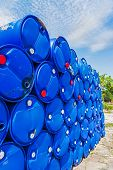 Chemical barrelsPlastic Storage Drums.Blue chemical barrels stacked up. poster