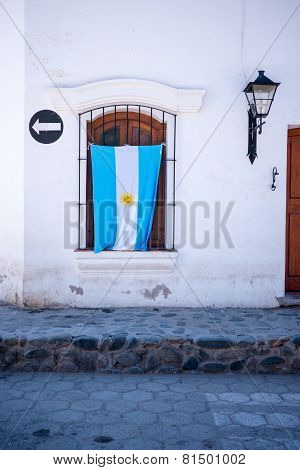 Argentinian Flag Hanging On Patriotic House In Small South American Town