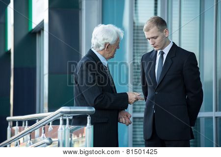 Senior Businessman Talking With His Employee