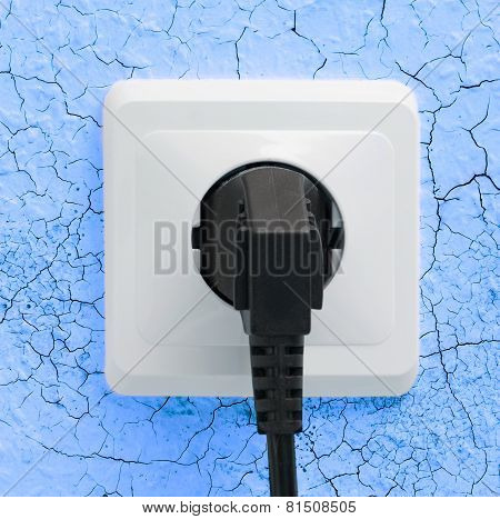 Wall plug socket on cracked colored wall background poster