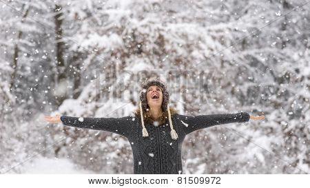 Happy Vivacious Woman Celebrating The Snow