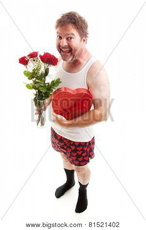 Scruffy middle aged man in his underwear with Valentines Day flowers and chocolates for his sweetheart.  Isolated on White