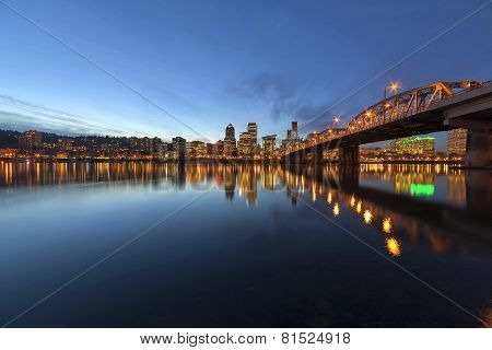 Portland Oregon Downtown City Skyline Along Willamette River by the Hawthorne Bridge at Evening Blue Hour poster