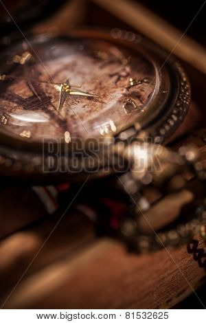 Pocket Watch Close-up Lying On Top Of The Package Of Cuban Cigar