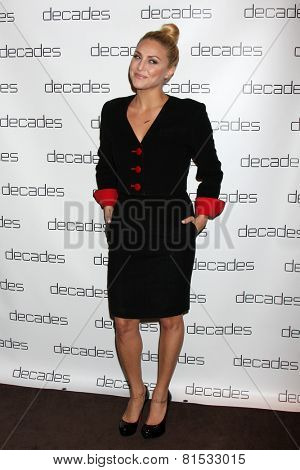 LOS ANGELES - MAR 20:  Cassie Scerbo at the Decades: Les Must De Moschino Event at Decades Boutique on March 20, 2014 in Los Angeles, CA