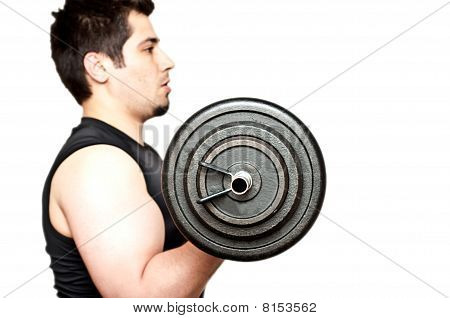 Young Man Performing A Bicep Curl