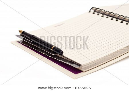 Organizer And Pen On A White Background
