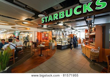 GENEVA - SEP 11: Starbucks cafe interior on September 11, 2014 in Geneva, Switzerland. Starbucks is the largest coffeehouse company in the world, with more then 23000 stores