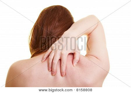 Woman With Back Pain From Behind