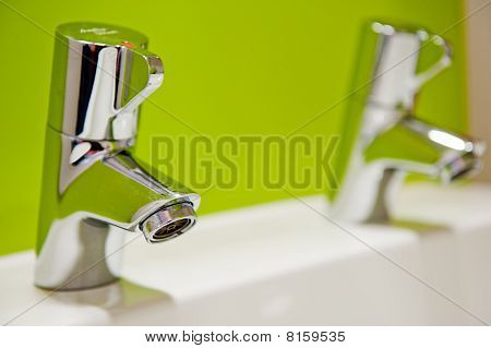 Water Tap With A Fresh Coloured Green Background