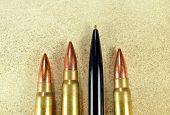 Pen and bullets as conceptual expression of the power of words poster