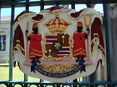"""Historic Royal Seal at Iolani Palace one of 16 Bronze Coat of Arms of the government of Hawaii with the state motto: """"Ua Mau Ke Ea o Ka Aina i ka Pono"""" (The life of the land is perpetuated in rightrousness). poster"""