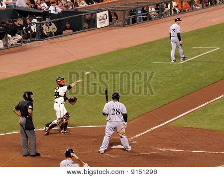 Giants Catcher Buster Posey Throws Ball Back To Pitcher During A Pitch Out To Brewers Prince Fielder